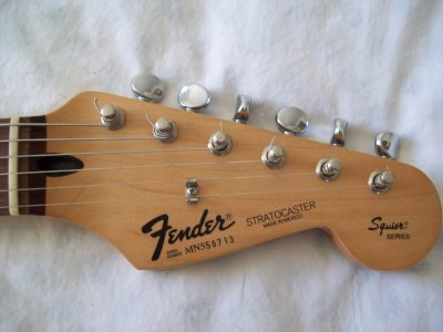 Fender MiM Strat - Squier Series - What's up with those